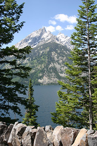 Grand Teton National Park is a United States National Park in northwestern Wyoming. At approximately 310,000 acres, the park includes the major peaks of the 40-mile-long Teton Range as well as most of the northern sections of the valley known as Jackson Hole. It is only 10 miles south of Yellowstone National Park, to which it is connected by the National Park Service-managed John D. Rockefeller, Jr. Memorial Parkway. Along with surrounding National Forests, these three protected areas constitute the almost 18,000,000-acre Greater Yellowstone Ecosystem, one of the largest intact mid-latitude temperate ecosystems in the world.